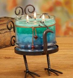 Metal Peacock Pillar Candle Holder   $30.00 www.AllThingsPeacock.com