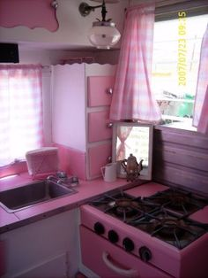 from vintage housewife blog, I've got the pink sink and stove but not quite THIS pink!Google Image Result for http://3.bp.blogspot.com/_nRgIM0cFZMs/SJtW8XAsdYI/AAAAAAAAAdA/jXJr4BltWXw/s400/trailer%2Bupdate%2B068.JPG