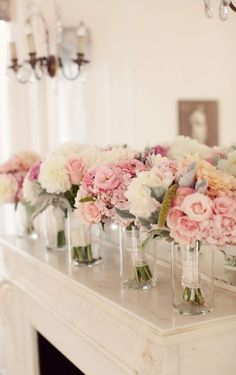 wedding party table, have empty vases lining the table for bridesmaids and bride to put their flowers in