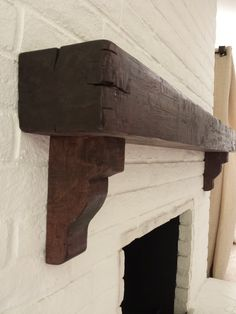 Distressed beam mantel with corbels by TheMantelGuy.com  Call for quote  310 977 3218