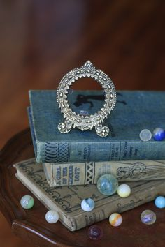 Exquisite Miniature Photo Frame for a Princess' Bedside. $18.50, via Etsy.  #Vintage #Home #Decor #Wall #Hanging #ornate #floral #tiny #silver #frame #picture #circle #victorian #silverplate #antique #art #nouveau #baroque #fancy