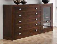 Aparador con 5 cajones + 1 puerta cristal, realizado en madera de nogal americano. Para salones comedores. Medidas: 183x40x101 cm.