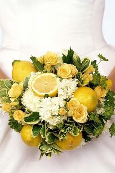 floral arrangements with cut and whole lemons