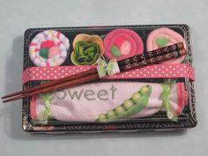 Super cute idea!  Baby Bib & Sushi Baby Girl Shower Gift - Sweet Pea - Baby Sushi Washcloths