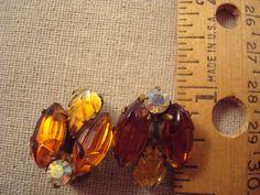 Vintage German amber rhinestone earrings, vintage topaz carved glass earrings, clip on earrings by snapconclusions on Etsy