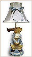 Peter Rabbit Table Lamp - Whether your little ones nursery is themed with Peter Rabbit motif, vintage bunnies or you're looking for that special piece to put the finishing touches on the room, this table lamp is just the thing. The hand painted base, white shade and charming ribbon make this lamp a real treasured keep sake.