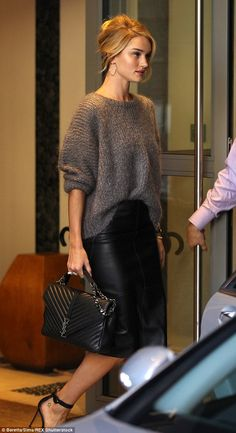 Cool and casual: Rosie Huntington-Whiteley nailed off-duty dressed in a slouchy grey jumper and leather pencil skirt as she headed out for the day in London on Wednesday
