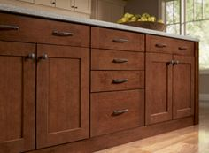 cherry spice mission cabinets - we didn't get these, but got something very similar from Schuler thru Lowe's