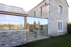 IQ Specialist Works designed and installed a glass link between a traditional cottage and new conservatory to merge the old with the new. Cottage Extension, House Extension Design, Glass Extension, Extension Ideas, House Design, Irish Cottage, Old Cottage, Glass Walkway, Cotswold House