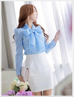 Morpheus Boutique  - Blue Chiffon Bow Ruffle Long Sleeve Celebrity Shirt, $59.99 (http://www.morpheusboutique.com/new-arrivals/blue-chiffon-bow-ruffle-long-sleeve-celebrity-shirt/)