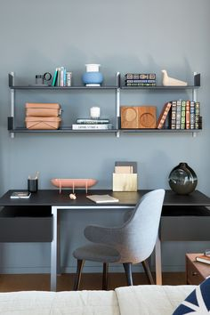 Interior Design by Falken Reynolds - Vancouver Home office with Vitsoe Shelving, Bensen Desk, and accessories. photo by Ema Peter