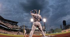 Jun 24, 2016; Pittsburgh, PA, USA; Los Angeles Dodgers right fielder Yasiel Puig (66) waits to bat in the on-deck circle against the Pittsburgh Pirates during the sixth inning at PNC Park. Mandatory Credit: Charles LeClaire-USA TODAY Sports