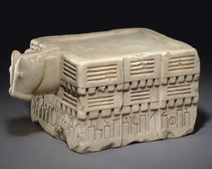 """South Arabian calcite libation table, 7th-6th century B.C. Rectangular table sculpted on three sides in three horizontal registers,  bottom register with an inscription reading  (Rt) 'b-wkl/bn/'b-'ns/s (Fnt) l'/c ttr/b'sn/yr (Lft) 'b/b-ywm/Smh-'mr, """"Ab-wakil, the son of Ab-anas, dedicated (this item) to 'Athtar Ba'san (=the Brave??), (when) he  an agreement/contract, in thetime of Sumhu-amir,""""  one side with bull head, 38.9 cm long. Private collection"""