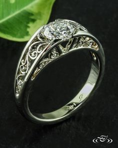 Filigree Initial Engagement RingWhite gold filigree curls form the initials E & B of the happy couple on the side face of this unique and personal engagement ring.#Ido #GreenLakeMade #EngagementRing