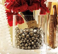 more jingle bell ideas. Just a centerpiece somewhere or place your bouquets in it like this one, but in a skinnier taller vase.