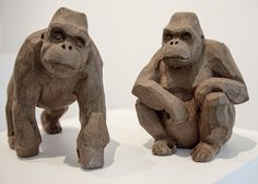 a pair of small gorillas made in ceramics. artist: Laurence Vallières Photo of José Enrique Montes Hernandez at Yves Laroche Gallery, Montreal.