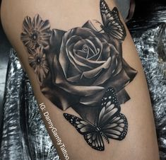 Realistic black and grey rose tattoo on a thigh with butterfly, this was the start of an ongoing thigh piece!