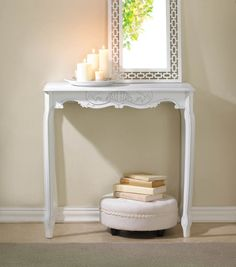 Make an impact in your entry with this beautifully detailed table. Choose from a weathered white finish or a statement making black. Elegant detail gives the appearance of a classic heirloom.