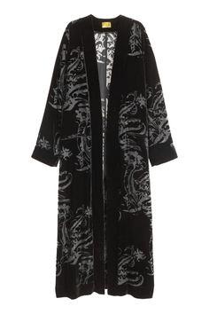 Layer a simple top and pants under this bold velvet kimono. H&M velvet kimono, $80. hm.com.