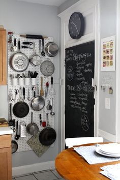 We spotted this smart use for a basic hardware store pegboard in Alison, Liz, & Nicole's Shared Space, entered in the 2014 Small Cool Contest. DIY this wall organizer by mounting a sheet of pegboard to a kitchen wall and using hooks or elastic to hang pots, pans, and tools and utensils.