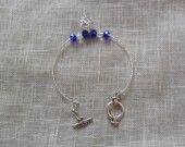 Bracelet perles en cristal bleues et transparentes.