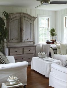 I'd add a little color by chalk painting the wooden cabinet and covering the throw pillows in colorful fabrics.