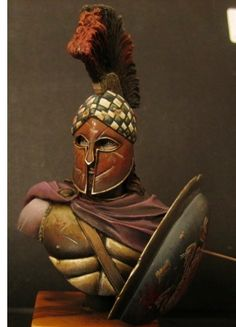 Statuette of a classical era Greek hoplite with a Corinthian style helmet. The colours of the helmet would be painted on.