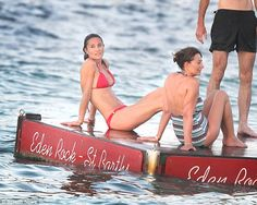 Pippa was pictured lounging on the pontoon in St Barts alongside her mother Carole, who wore a patterned one-piece