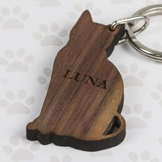 Solid walnut wood, cat shaped, nickel plated keyring. Personalised with up to 8 characters. Dimensions: 6cm(H) x 3cm(W).
