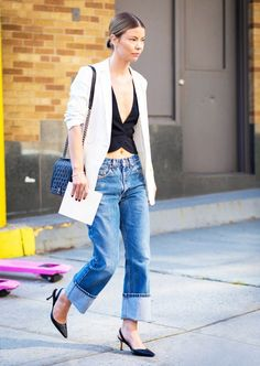 Cuffed boyfriend jeans are worn with black pointed-toe heels, a black tank and a pinstripe blazer.