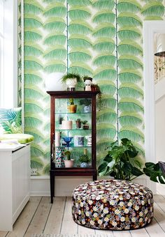 Palm Leaf Wallpaper from Sanderson created the idea for this apartment's 'green corner'.