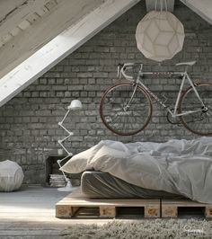 Brick wall, white-greyish tones, upcycled pallet bed, geometrical design…