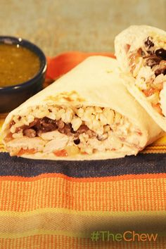 Don't miss out on this tasty burrito smothered in green sauce! Eat this Chicken Burritos with Chile Verde & Spicy Black Beans for dinner.