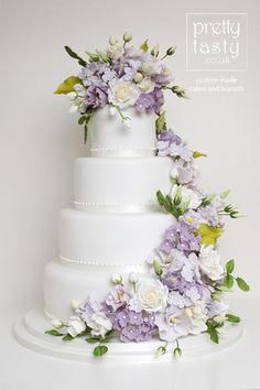 Elegant floral cascade in purple and green - Floral cascade with white roses, purple lisianthus and purple hydrangeas. Wedding Cake Roses, Purple Wedding Cakes, Wedding Cakes With Flowers, Elegant Wedding Cakes, Beautiful Wedding Cakes, Wedding Cake Designs, Wedding Cake Toppers, Beautiful Cakes, Wedding Cake Vintage