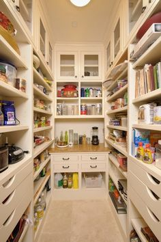awesome pantry charisma design,  I love how there are so many short shelves and they are adjustable!  And the drawers! Perfect for tablecloths and place mats.