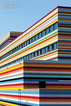 Color Field: A Rainbow-Bright Berlin Hotel by Peterse Architekten and Studio Aisslinger   The steel panels of the Meininger Hotel Berlin Airport are coated in 11 colors of a polyester-varnished zinc-magnesium alloy that is antiglare and UV-stable. #design #interiordesign #interiordesignmagazine #color #architecture