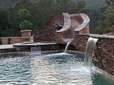 gorgeous stone slide, pool, jacuzzi and fountains built by Blue Pacific Pools, check out our website for more! http://www.bluepacificpools.com/index.html