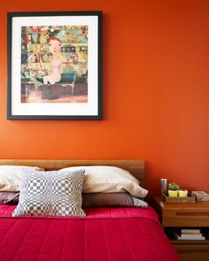 I am thinking of painting my living room this color, we have so much wood and the copper/orange makes everything cozy. Might be too psycho with the tile fireplace though- or AWESOME.