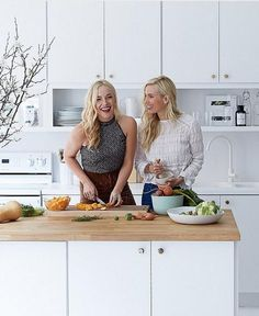 """Best friends Danielle and Whitney make the most of their multi-functional office space, whipping up a delicious and healthy meal in the sleek, all-white office kitchen. See the full, light + airy Manhattan office tour and get more inspiring, healthy recipes on """"The Founders of Sakara Reveal Their Secrets"""" on the One Kings Lane Style Guide!"""