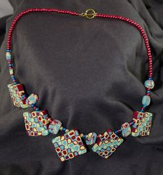 Playful red, yellow, and blue necklace