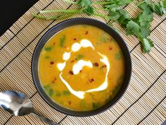 Spicy coconut pumpkin soup -- very flavorful, but a bit watery. I would halve the water next time.
