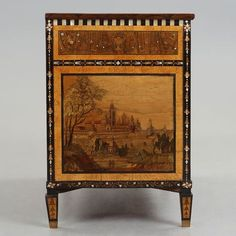 A RUSSIAN LATE 18TH CENTURY COMMODE. Veneered with Karelian birch, walnut, mother of pearl and colored woods. Brass handles. Three drawers. Rich inlays of Russian city motifs, as well as winged figures and leaf ranks. Length 130.5, width 61.5, height 90.5 cm. Key included. Key included.