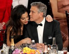 Getting cosy: Amal wrapped an arm around her actor husband during the event - Golden Globes - Jan. 11, 2015.