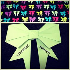 Origami Bow. If it's small enough you could make them as cheer clinic name tags. Or if you have a cubby for cheer or gymnastics you could us this as a label.