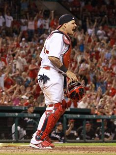 St. Louis Cardinals catcher Yadier Molina reacts after a double-play ended the game with the bases loaded during a game between the St. Loui...
