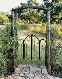 Old bed frame turned into a gate  http://all-things-lovely.blogspot.com/