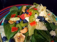 Tropical Jungle Salad  Calories 110 Fat, Protein 4g, Fat 2g, Carbs 18  Ingredients:  1/3 Cup Chopped Celery  1/4 Cup Blueberries  1 Cup Spinach  1 Cup Iceberg  2 Tbsp Tropical Trail Mix  1 Tbsp Feta Cheese