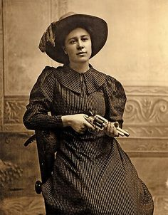 25 Rose of CimarronRose Dunn became known as Rose of Cimarron at the age of 15 after she reportedly came to the aid of her outlaw boyfriend during a gunfight between lawmen and outlaws in Ingalls, Oklahoma Territory, in 1895. Some debate whether this photo was taken to promote the 1915 movie The Passing of the Oklahoma Outlaws, but this photo definitely dates to the 1890s.– Courtesy Robert G. McCubbin Collection –