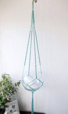 Macrame plant hanger is made from 3mm durable Polypropylene braided cord. On the photo it is made of turquoise cord. It can be used indoors and outdoors, and it can withstand outdoor conditions. It is 42 (105 cm) long from the top loop to the end of the basket not including the tassel.