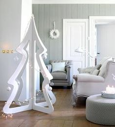 Xmas, drill holes along edges to hang ornaments, or cut out ridges, like on some hangers, to stream lights or garland